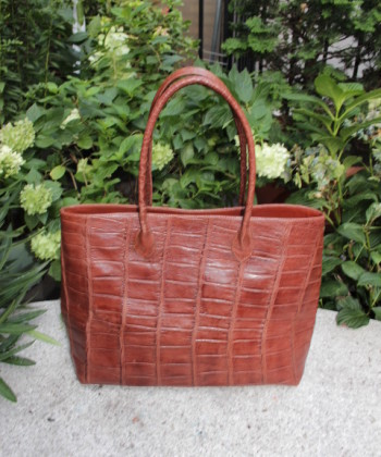 woman alligator hand bag
