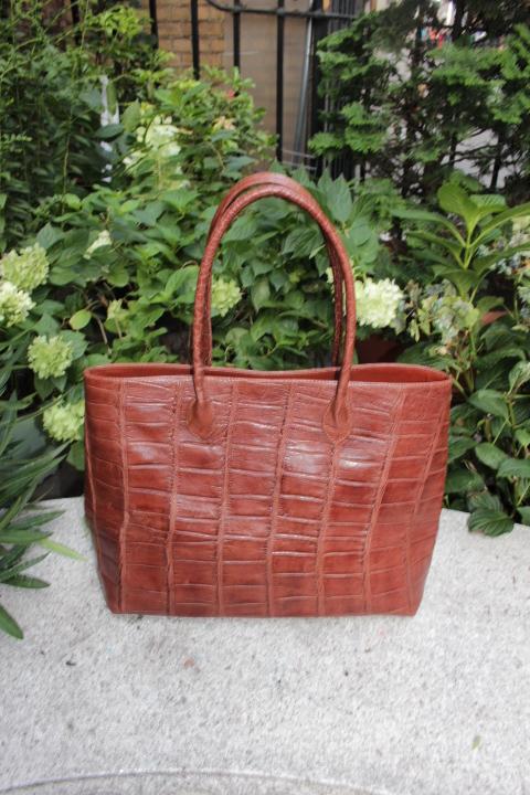 woman  alligator hand bag