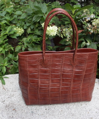 women alligator hand bag